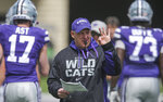 FILE - In this April 13, 2019, file photo, new Kansas State head coach Chris Klieman leads his team through their final NCAA college spring football practice, in Manhattan, Kan. Klieman, who led North Dakota State to four FCS titles the past five seasons, took over when 79-year-old Bill Snyder retired for a second time. The Wildcats won 215 games in his 27 seasons. (Travis Heying/The Wichita Eagle via AP, File)
