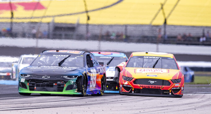 The car of Ryan Newman (6), right, makes contact with the car driven by Erik Jones (43), center, at Turn 5 during a NASCAR Cup Series auto race at Indianapolis Motor Speedway, Sunday, Aug. 15, 2021, in Indianapolis. (AP Photo/Doug McSchooler)