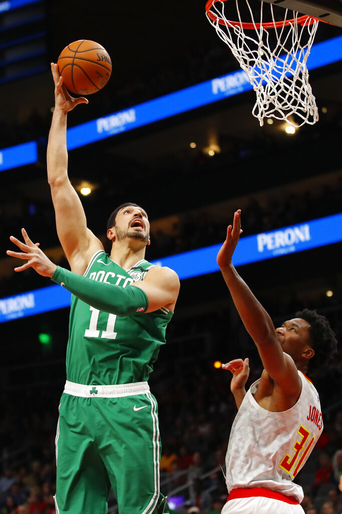 Boston Celtics center Enes Kanter (11) goes up for the shot in the first half of an NBA basketball game against the Atlanta Hawks on Monday, Feb. 3, 2020, in Atlanta. (AP Photo/Todd Kirkland)