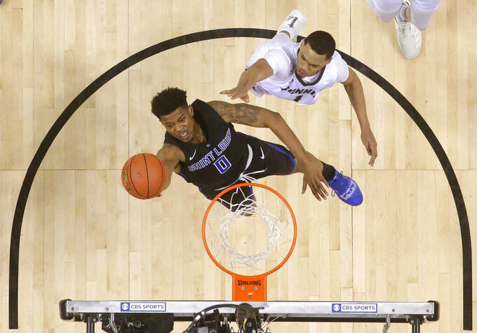 Saint Louis guard Jordan Goodwin (0) goes up for a shot against St. Bonaventure guard Dominick Welch during the first half of an NCAA college basketball game in the Atlantic 10 men's tournament final Sunday, March 17, 2019, in New York. Saint Louis won 55-53. (AP Photo/Julio Cortez)