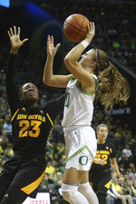 Oregon's Sabrina Ionescu, right, shoots over Arizona State's Iris Mbulito during the third quarter of an NCAA college basketball game in Eugene, Ore., Sunday, Feb. 9, 2020. (AP Photo/Chris Pietsch)