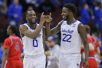 Seton Hall's Quincy McKnight, left, and Myles Cale celebrate after an NCAA college basketball game against St. John's in Newark, N.J., Sunday, Feb. 23, 2020. Seton Hall defeated St. John's 81-65. (AP Photo/Seth Wenig)