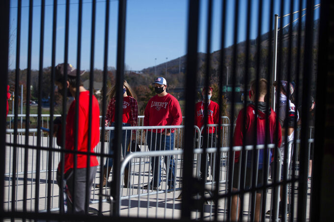 Liberty University fans wait outside the stadium before a NCAA college football game between Western Carolina and Liberty University on Saturday, Nov. 14, 2020 at Williams Stadium in Lynchburg, Va. (AP Photo/Shaban Athuman)
