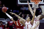 Oklahoma forward Jalen Hill (1) tries to block a shot b y Stanford guard Bryce Wills (2) during the first half of an NCAA college basketball game Monday, Nov. 25, 2019, in Kansas City, Mo. (AP Photo/Charlie Riedel)