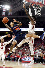 Auburn's J'Von McCormick (55) tries to get past Arkansas defender Adrio Bailey, right during the second half of an NCAA college basketball game Tuesday, Feb. 4, 2020, in Fayetteville, Ark. (AP Photo/Michael Woods)