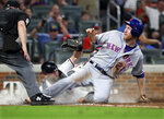 Atlanta Braves catcher Brian McCann tags out New York Mets' Todd Frazier at the plate on a throw from Ronald Acuna Jr. during the sixth inning of a baseball game Tuesday, Aug. 13, 2019, in Atlanta. (Curtis Compton/Atlanta Journal-Constitution via AP)