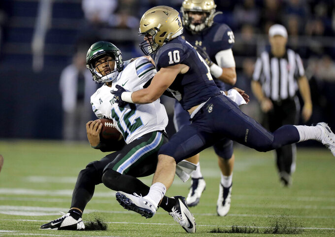 Tulane quarterback Justin McMillan (12) is tackled by Navy safety Kevin Brennan (10) during the second half of an NCAA college football game, Saturday, Oct. 26, 2019, in Annapolis. Navy won 41-38. (AP Photo/Julio Cortez)