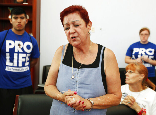 FILE - In this July 28, 2009 file photo, Norma McCorvey, the plaintiff in the landmark lawsuit Roe v. Wade, speaks as she joins other anti-abortion demonstrators inside House Speaker Nancy Pelosi's office on Capitol Hill in Washington. In a 2020 documentary, she admitted she was paid by anti-abortion activists for her inauthentic conversion. (AP Photo/Manuel Balce Ceneta)