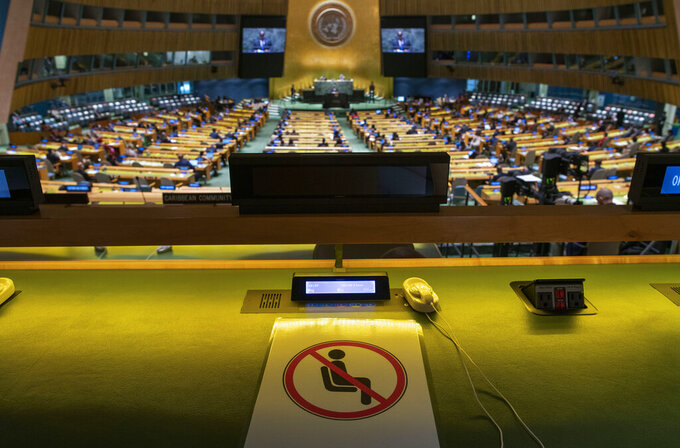 A seat is marked off for social distancing because of the coronavirus disease (COVID-19) pandemic as Democratic Republic of Congo President Felix Tshisekedi addresses the 76th Session of the U.N. General Assembly Tuesday, Sept. 21, 2021. (Eduardo Munoz/Pool Photo via AP)