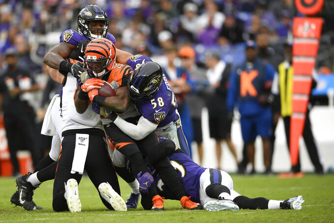 Cincinnati Bengals running back Giovani Bernard (25) is tackled by Baltimore Ravens linebacker L.J. Fort (58) during the second half of a NFL football game Sunday, Oct. 13, 2019, in Baltimore. (AP Photo/Nick Wass)