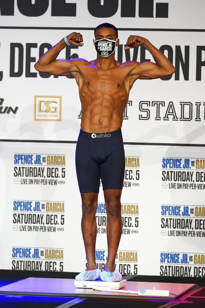 Boxer Errol Spence Jr., poses as he weighs in for a title match against Danny Garcia in Dallas, Friday, Dec. 4, 2020. Spence Jr. is putting his WBC and IBF welterweight titles on the line against Danny Garcia in his first fight since escaping serious injury in a high-speed car wreck in Dallas that led to misdemeanor drunken driving charges and could have derailed a promising career. The 30-year-old Spence is undefeated in 26 fights with 21 knockouts. Garcia, a 32-year-old from Philadelphia, is 36-2 and has 21 knockouts as well.(AP Photo/Tony Gutierrez)