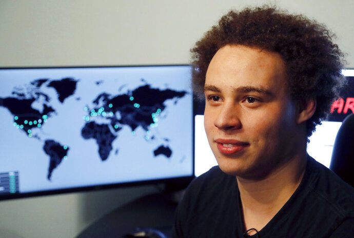 FILE - This May 15, 2017, file photo shows British cybersecurity expert Marcus Hutchins during an interview in Ilfracombe, England. Hutchins, accused of creating and distributing malware designed to steal banking passwords, is headed to court Wednesday, May 16, 2018, in Milwaukee for a hearing on what evidence may be used in the case. Federal prosecutors in Milwaukee say Hutchins acknowledged in recorded jailhouse phone calls that code he wrote wound up in malware, and they want to introduce that evidence. (AP Photo/Frank Augstein, File)
