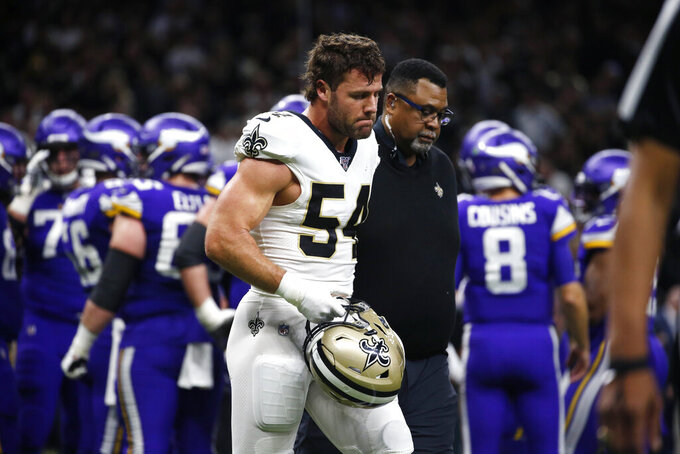 An injured New Orleans Saints outside linebacker Kiko Alonso (54) walks off the field in the first half of an NFL wild-card playoff football game against the Minnesota Vikings, Sunday, Jan. 5, 2020, in New Orleans. (AP Photo/Butch Dill)