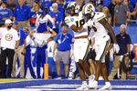 Missouri wide receiver Chance Luper (18) help up wide receiver Keke Chism (6) after a missed catch during the second half of the team's NCAA college football game against Missouri in Lexington, Ky., Saturday, Sept. 11, 2021. (AP Photo/Michael Clubb)