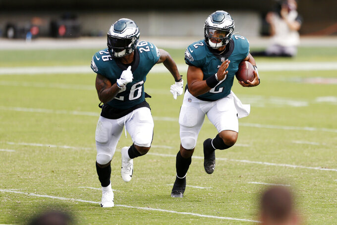 Philadelphia Eagles' Jalen Hurts (2) and Miles Sanders (26) run during the second half of an NFL football game against the Cincinnati Bengals, Sunday, Sept. 27, 2020, in Philadelphia. (AP Photo/Laurence Kesterson)