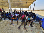 Rescued migrants rest near the city of Khoms, around 120 kilometers (75 miles) east of Tripoli, Libya., Tuesday, Aug. 27, 2019. At least 65 migrants, mostly from Sudan, were rescued, said a spokesman for Libya's coast guard, with a search halted for those still missing. The coast guard gave an estimate for those missing and feared drowned of 15 to 20 people.(AP Photo/Hazem Ahmed)
