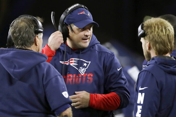 FILE - In this Oct. 10, 2019, file photo, New England Patriots special teams coach Joe Judge, center, speaks to head coach Bill Belichick, left, and safeties coach Steve Belichick, right, in the second half of an NFL football game in Foxborough, Mass. The New York Giants and Patriots assistant Joe Judge are working on a deal for him to become the team's head coach, a person familiar with the negotiations told The Associated Press The person spoke to the on condition of anonymity Tuesday, Jan. 7, 2020, because the deal is not done. (AP Photo/Elise Amendola, File)