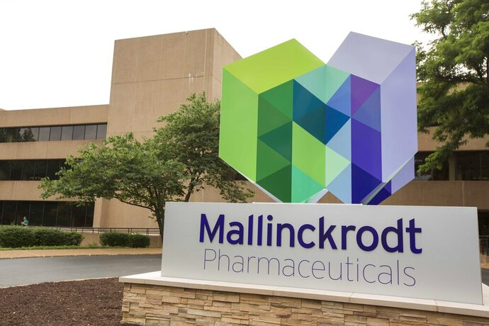 FILE - This July 1, 2013, file photo, shows the exterior of the Mallinckrodt Pharmaceuticals office in St. Louis. Mallinckrodt is seeking protection in federal bankruptcy court, as the generic drugmaker deals with lawsuits over its role in the U.S. opioid crisis. The company said Monday, Oct. 12, 2020, that it voluntarily started Chapter 11 proceedings to reduce debt and resolve several billion dollars of possible legal liabilities. (Whitney Curtis/AP Images for Mallinckrodt, File)