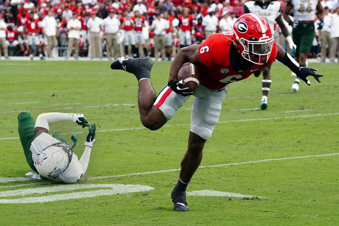 Georgia running back Kenny McIntosh (6) runs past a UAB defender as he runs for a touchdown after a catch during the first half of an NCAA college football game Saturday, Sept. 11, 2021, in Athens, Ga. (AP Photo/John Bazemore)