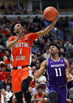 Illinois guard Trent Frazier, left, drives to the basket as Northwestern guard Anthony Gaines looks on during the second half of an NCAA college basketball game in the first round of the Big Ten Conference tournament in Chicago, Wednesday, March 13, 2019. Illinois won 74-69 in overtime. (AP Photo/Nam Y. Huh)
