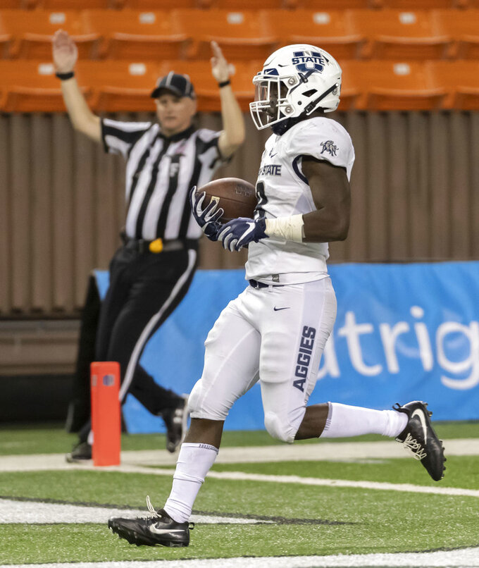 Utah State running back Gerold Bright (8) runs in for a touchdown in the second half of an NCAA college football game against Hawaii, Saturday, Nov. 3, 2018, in Honolulu. (AP Photo/Eugene Tanner)