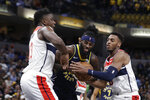 Indiana Pacers forward JaKarr Sampson (14) is defended by Washington Wizards center Thomas Bryant, left, and guard Troy Brown Jr. during the second half of an NBA basketball game Wednesday, Nov. 6, 2019, in Indianapolis. Indiana won 121-106. (AP Photo/Darron Cummings)