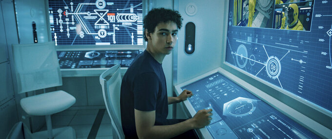 """This image released by Lionsgate shows Archie Madekwe in a scene from """"Voyagers."""" (Lionsgate via AP)"""