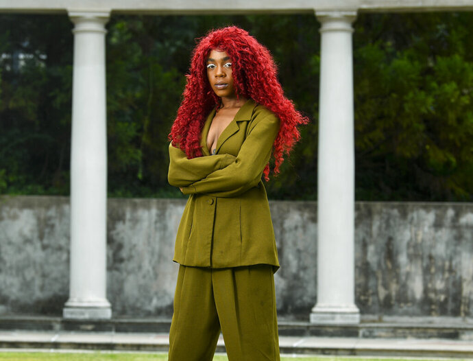 This Aug. 19, 2019 photo shows music artist Buku Abi, born Joann Kelly, posing in Atlanta. As the daughter of R. Kelly, she experienced her fair share of hardships. She is no longer in touch with him and says being R. Kelly's daughter is like
