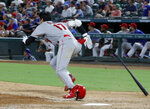 Los Angeles Angels' Shohei Ohtani sprints out of the box after hitting an RBI double off Texas Rangers' Shawn Kelley during the eighth inning of a baseball game in Arlington, Texas, Tuesday, Aug. 20, 2019. (AP Photo/Tony Gutierrez)
