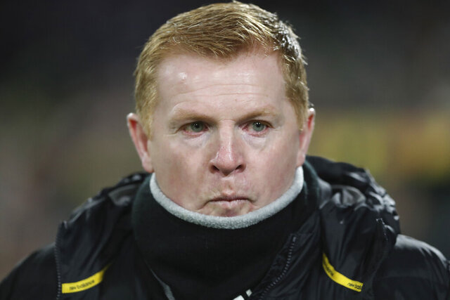 FILE - In this Thursday, Feb. 27, 2020 file photo, Celtic manager Neil Lennon looks on prior to the Europa League round of 32, second leg soccer match between Celtic and FC Copenhagen at the Celtic Park stadium in Glasgow, Scotland. Scottish giant Celtic is in crisis and its manager is fighting for his job. The Glasgow team has had an unprecedented run of sustained success in recent years but is out of European competition already and 11 points behind great rival Rangers in a faltering bid for a record 10th straight Scottish Premiership title.  (AP Photo/Scott Heppell, File)