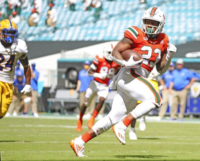 Miami running back Cam'Ron Harris (23) runs for a first quarter touchdown after a reception against Pittsburgh during an NCAA college football game at Hard Rock Stadium in Miami Gardens, Fla., Saturday, Oct. 17, 2020. (Al Diaz/Miami Herald via AP)