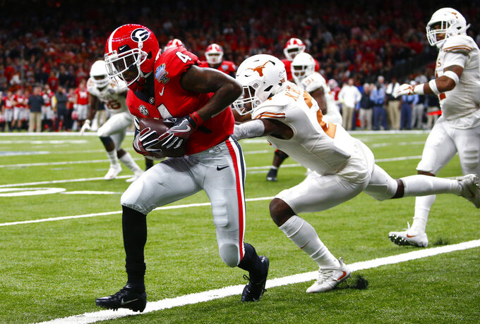 Georgia wide receiver Mecole Hardman (4) scores a touchdown against Texas defensive back Kris Boyd (2) during the second half of the Sugar Bowl NCAA college football game in New Orleans, Tuesday, Jan. 1, 2019. (AP Photo/Butch Dill)