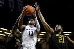 Kansas State's Antonio Gordon (11) shoots under pressure from Alabama State's Mike Stone (21) and Leon Daniels (1) during the second half of an NCAA college basketball game Wednesday, Dec. 11, 2019, in Manhattan, Kan. (AP Photo/Charlie Riedel)