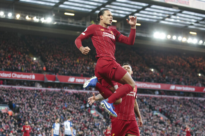 Liverpool's Virgil van Dijk celebrates after scoring during the English Premier League soccer match between Liverpool and Brighton at Anfield Stadium, Liverpool, England, Saturday, Nov. 30, 2019. (AP Photo/Jon Super)