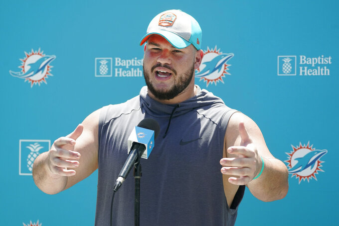 Miami Dolphins guard Durval Queiroz Neto, of Brazil, speaks to members of the media after a practice at the NFL football team's training facility, Friday, Aug. 6, 2021, in Miami Gardens, Fla. (AP Photo/Wilfredo Lee)