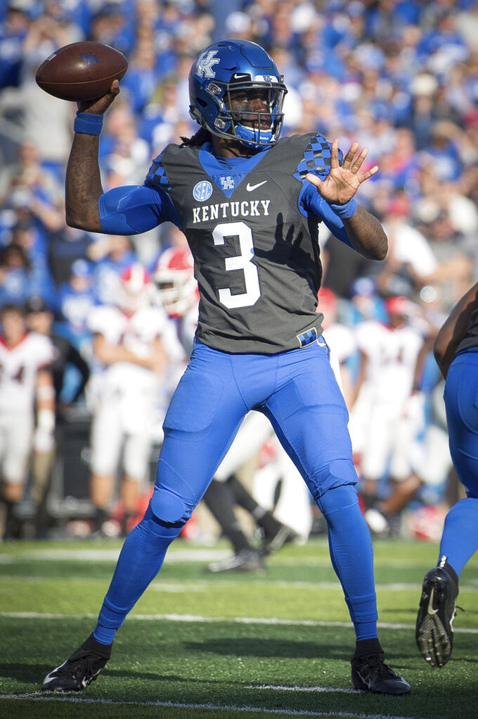 Kentucky quarterback Terry Wilson (3) throws a pass during the first half an NCAA college football game against Georgia in Lexington, Ky., Saturday, Nov. 3, 2018. (AP Photo/Bryan Woolston)