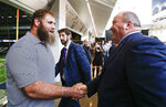 New Dallas Cowboys head coach Mike McCarthy, right, greets player Travis Frederick after a press conference at the Dallas Cowboys headquarters Wednesday, Jan. 8, 2020, in Frisco, Texas. (AP Photo/Brandon Wade)