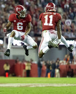 FILE - In this Saturday, Nov. 24, 2018, file photo, Alabama wide receivers DeVonta Smith (6) and Henry Ruggs III (11) celebrate a touchdown reception by Ruggs during the second half of an NCAA college football game against Auburn in Tuscaloosa, Ala. The Tide hasn't had a Top 15 offense under coach Nick Saban. Enter Tua Tagovailoa. And Jerry Jeudy. And fellow receivers Henry Ruggs III, DeVonta Smith and freshman Jaylen Waddle. Plus tight end Irv Smith Jr. Not to mention tailbacks Damien Harris, Najee Harris and Josh Jacobs.  (AP Photo/Vasha Hunt, File)