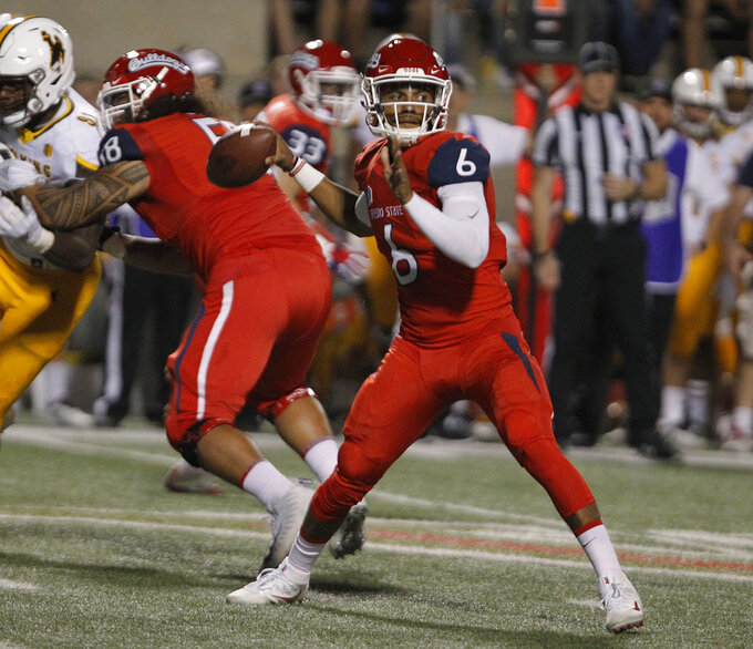 Fresno State quarterback Marcus McMaryion drops back to pass during the first half of an NCAA college football game against Wyoming in Fresno, Calif., Saturday, Oct. 13, 2018. (AP Photo/Gary Kazanjian)