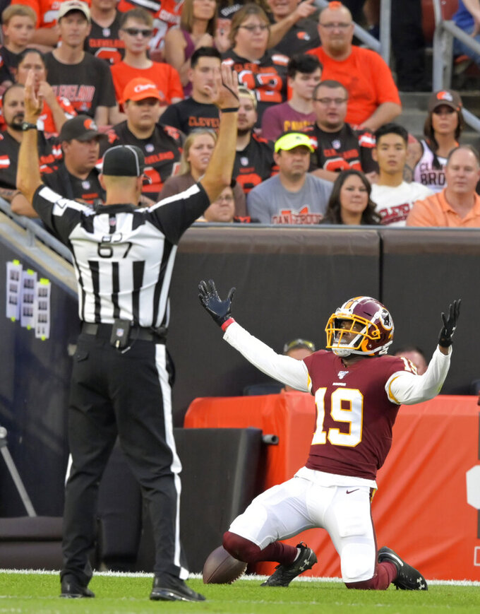 Washington Redskins wide receiver Robert Davis (19) reacts after a 46-yard touchdown during the first half of the team's NFL preseason football game against the Cleveland Browns, Thursday, Aug. 8, 2019, in Cleveland. (AP Photo/David Richard)