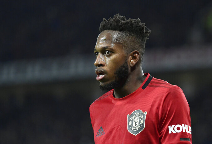 """FILE - In this Wednesday, Dec. 4, 2019 file photo, Manchester United's Fred looks on during their English Premier League soccer match against Tottenham Hotspur at Old Trafford in Manchester, England. Manchester United midfielder Fred says he finally feels settled at the club after what he described as an """"awful"""" first year in English soccer because of personal issues. The Brazil international believes he had rediscovered some of his best form before the suspension of the Premier League because of the coronavirus outbreak. (AP Photo/Rui Vieira, file)"""