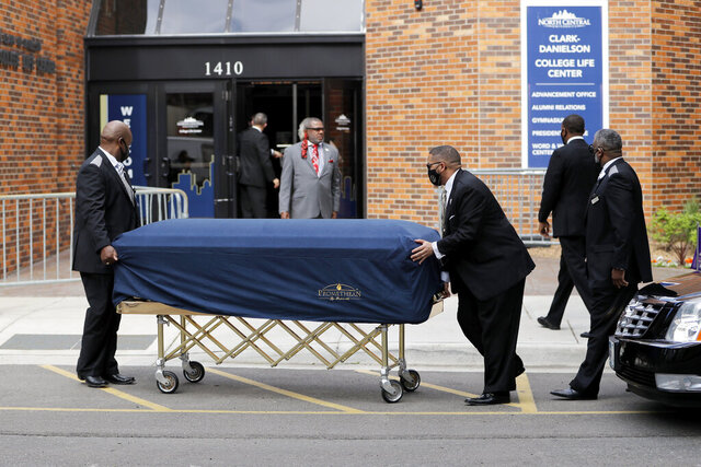 The body of George Floyd arrives before his memorial services on Thursday, June 4, 2020 in Minneapolis. (AP Photo/Julio Cortez)