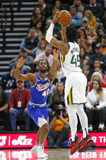 Utah Jazz guard Donovan Mitchell (45) shoots as Sacramento Kings forward Harrison Barnes (40) defends during the first half during an NBA basketball game Saturday, Jan. 18, 2020, in Salt Lake City. (AP Photo/Rick Bowmer)