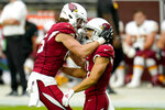 Arizona Cardinals wide receiver Andy Isabella, right, celebrates a first down with teammate Dan Arnold during the first half of an NFL football game against the Washington Football Team, Sunday, Sept. 20, 2020, in Glendale, Ariz. (AP Photo/Ross D. Franklin)