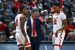 Texas Tech coach Chris Beard talks to Kyler Edwards (0) and TJ Holyfield (22) during the first half of an NCAA college basketball game against Eastern Illinois, Tuesday, Nov. 5, 2019, in Lubbock, Texas. (AP Photo/Brad Tollefson)