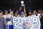Duke players celebrate with the trophy after defeating Georgetown 81-73 in an NCAA college basketball game for the 2K Empire Classic championship, Friday, Nov. 22, 2019 in New York. (AP Photo/Kathy Willens)