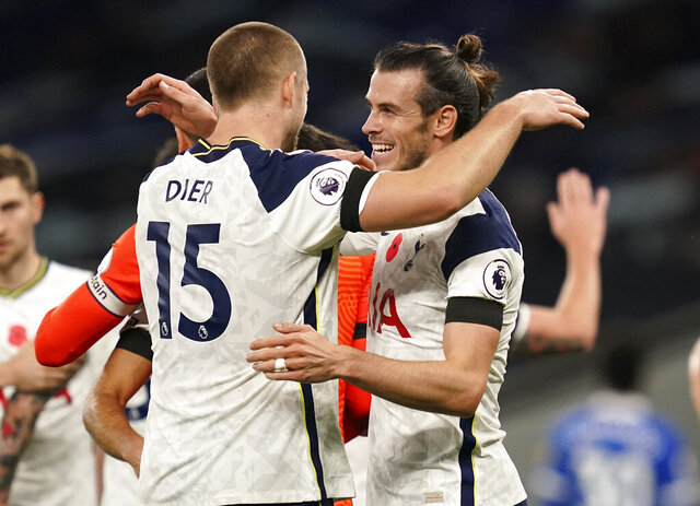 Tottenham's Gareth Bale, right, celebrates with teammate Eric Dier following the English Premier League soccer match between Tottenham Hotspur and Brighton & Hove Albion at Tottenham Hotspur Stadium, London, Sunday, Nov. 1, 2020. (John Walton/Pool via AP)