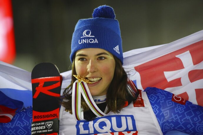 Slovakia's Petra Vlhova bites her gold medal of the women's giant slalom, at the alpine ski World Championships in Are, Sweden, Thursday, Feb. 14, 2019. (AP Photo/Marco Trovati)