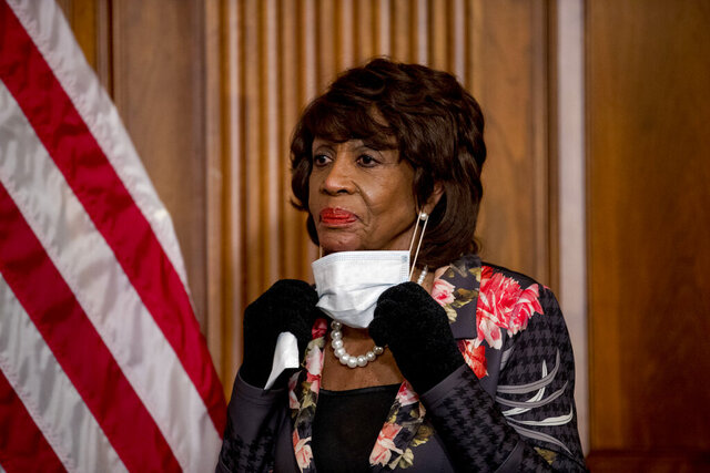 FILE - In this April 23, 2020, file photo House Financial Services Committee Chairwoman Maxine Waters, takes her mask off to speak during a signing ceremony for the Paycheck Protection Program and Health Care Enhancement Act, H.R. 266, after it passed the House on Capitol Hill, in Washington. Maxine Waters said she started focusing on police violence in 1979 after Los Angeles police shot a Black homemaker, Eula Love, during a confrontation over an unpaid gas bill.  (AP Photo/Andrew Harnik, File)