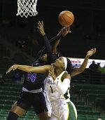Central Arkansas forward Lucy Ibeh, left, attempts a shot over Baylor forward NaLyssa Smith during the first half of an NCAA college basketball game Wednesday, Nov. 25, 2020, in Waco, Texas. (Rod Aydelotte/Waco Tribune Herald via AP)